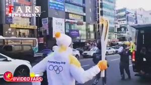 حمل مشعل المپیک توسط بهرام رادان