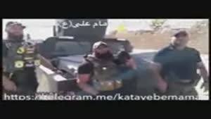ابوعزراییل در کنار خودرو زرهی کتایب امام علی