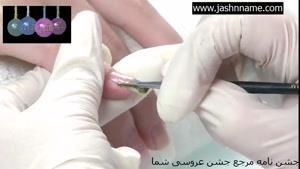 یک مدل طراحی روی ناخن