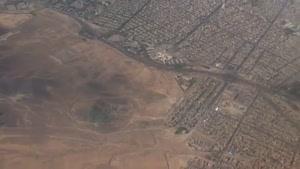 نمایی از شهر مشهد و و فرود در باند فرودگاه مهرآباد