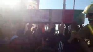 تشییع شهدای آتشنشان حادثه پلاسکو روی دوش مردم