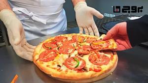 پخت پیتزا در آشپزخانه بروج